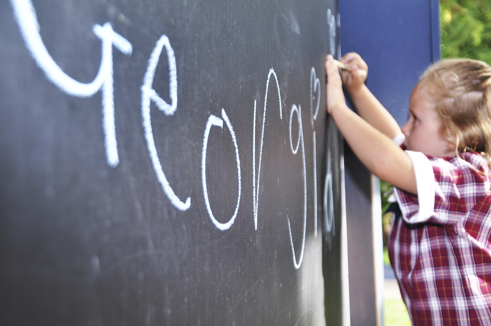 Girl at chalkboard. iStock_000075329265_Full.jpg
